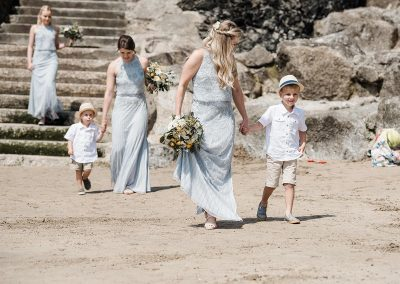 Bridesmaids and page boys on Polzeath beach