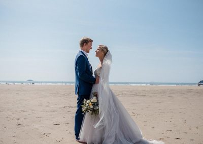 Bride and groom on Polzeath beach