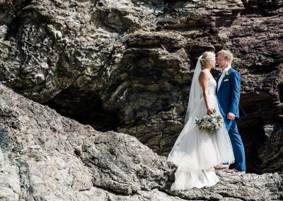 Bride and groom on cliffs at Polzeath